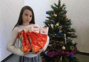 Нижнекамская мини-мисс приняла участие в акции НТР «Стань Дедом Морозом!»